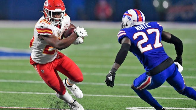 In this Monday, Oct. 19, 2020, file photo, Kansas City Chiefs running back Clyde Edwards-Helaire (25) runs the ball as Buffalo Bills cornerback Tre'Davious White (27) defends during the second half of an NFL football game, in Orchard Park, N.Y.