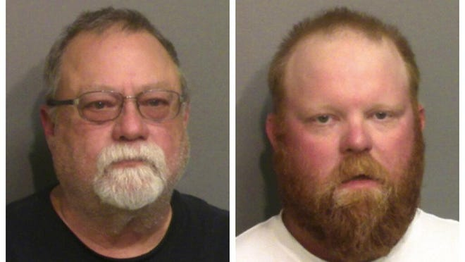 This photo combo of images taken Thursday, May 7, 2020, and provided by the Glynn County Detention Center, in Georgia, show Gregory McMichael, left, and his son Travis McMichael. The two have been charged with murder in the February shooting death of Ahmaud Arbery, whom they had pursued in a truck after spotting him running in their neighborhood.