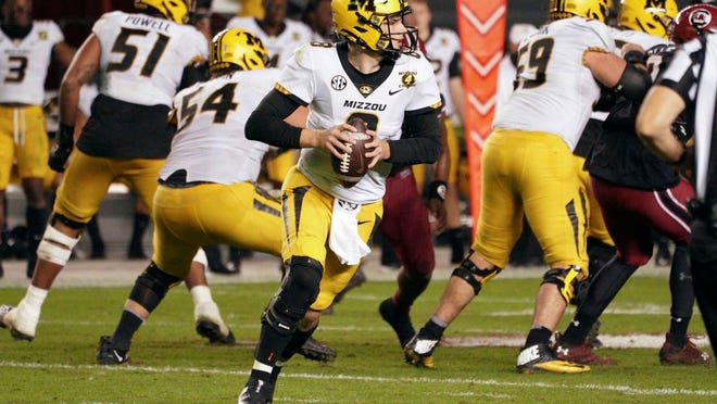 Missouri quarterback Connor Bazelak (8) looks for an open receiver during the second half of an NCAA college football game against South Carolina, Saturday, Nov. 21, 2020, in Columbia, S.C.