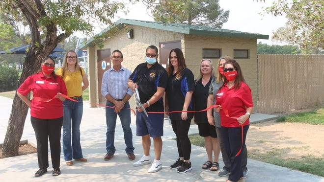 Jason Patin cuts the ribbon officiating improvements to freedom park earlier this year.