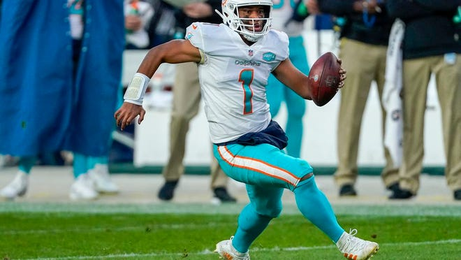 Miami Dolphins quarterback Tua Tagovailoa (1) runs against the Denver Broncos during an NFL football game Sunday, Nov. 22, 2020, in Denver.