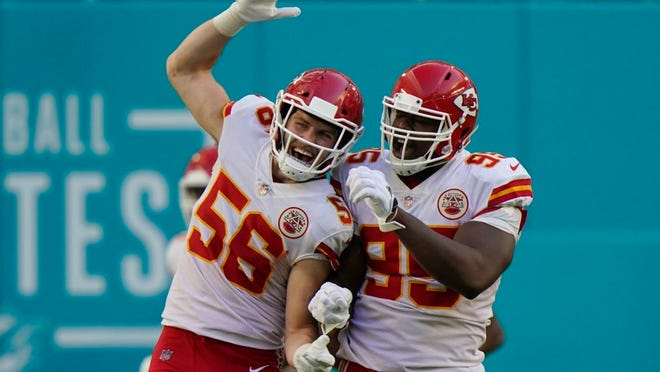 Kansas City Chiefs outside linebacker Ben Niemann (56) and defensive tackle Chris Jones (95) celebrate after Jones sacked Miami Dolphins quarterback Tua Tagovailoa in the enzone for a safety, during the second half of an NFL football game, Sunday, Dec. 13, 2020, in Miami Gardens, Fla.