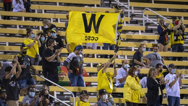 Fans celebrate during the second half after the Columbus Crew scored their second goal during their match against FC Cincinnati at MAPFRE Stadium in Columbus, Ohio, on Sept. 6, 2020. The Crew would go on to shut out Cincinnati, 3-0.