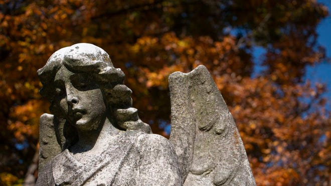 This angel statue in West State Street Cemetery in Athens was placed there in 1924 in honor of the cemetery's unknown dead.