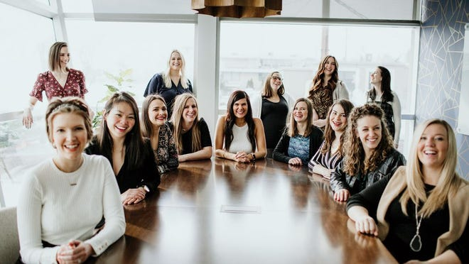 The Belle Communication team with founder and CEO Kate Finley in the center.