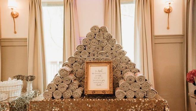 Jessica and Corey Sprang used cozy throws as favors for their wedding.