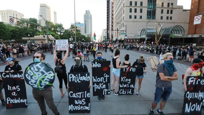 Protesters take over the Broad and High intersection Saturday, June 6, in Columbus. Protest leaders encouraged white participants to hold shields, allowing black protesters space inside the square.