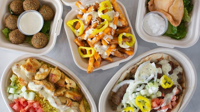 Clockwise from bottom left: chicken shawarma on rice, falafel, Greek fries, Sambosek and gyro with everything from Zaytoon Mediterranean Grill.