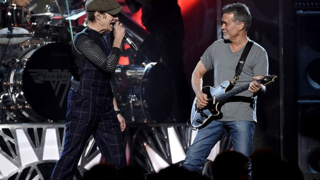 David Lee Roth, left, and Eddie Van Halen of Van Halen perform at the Billboard Music Awards at the MGM Grand Garden Arena on Sunday, May 17, 2015, in Las Vegas.