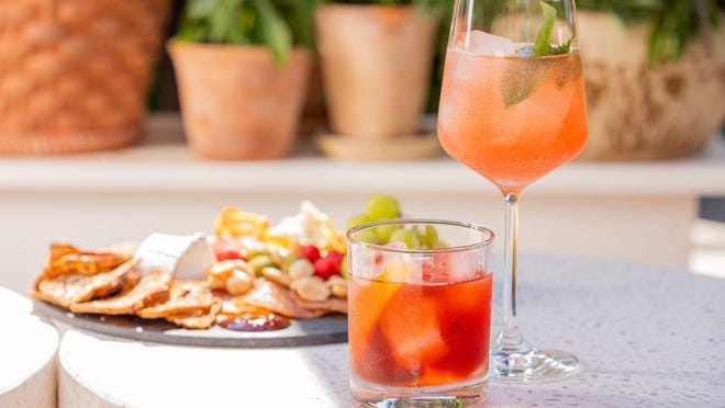 A Negroni, House Spritz and charcuterie board at Coast Wine House