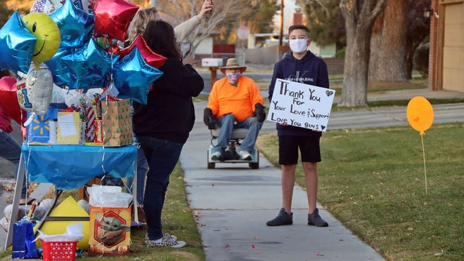 Mikey Santiago, 13, was diagnosed with a brain tumor last week. Family and friends gathered at Heritage Park in their cars, before driving by the home one by one to show their support.