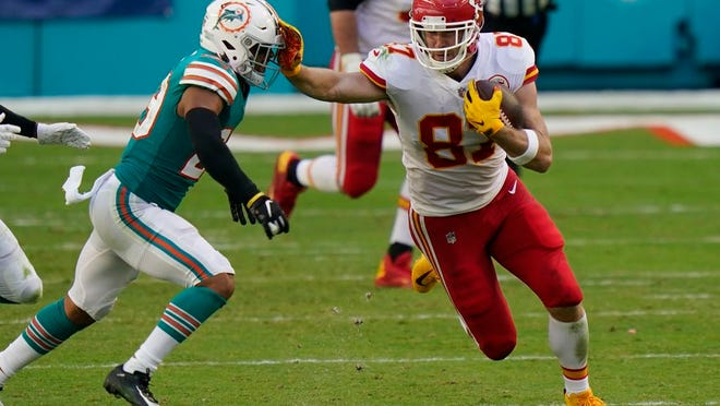 Kansas City Chiefs tight end Travis Kelce (87) stops Miami Dolphins free safety Brandon Jones (29), during the first half of an NFL football game, Sunday, Dec. 13, 2020, in Miami Gardens, Fla.
