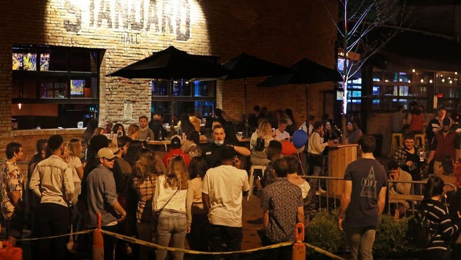 In spite of COVID-19 crowd limitations, a crowd gathers to drink at Standard Hall, a bar in Columbus' Short North Art District, on Friday, May 15, about 11 p.m.