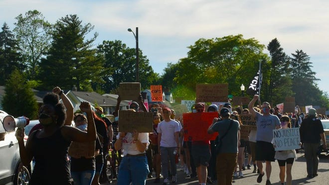CPD out of CCS organizers lead a march in early June.