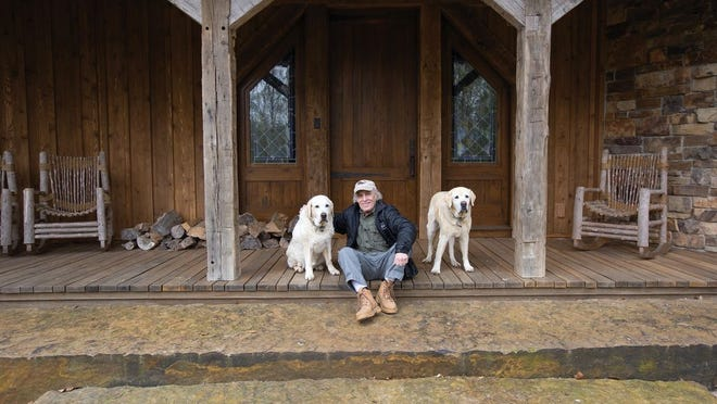 Joel Slaven with his dogs, Journey and Wrangler, at his Licking County home
