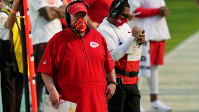 Kansas City Chiefs head coach Andy Reid watches his team during the first half of an NFL football game against the Miami Dolphins, Sunday, Dec. 13, 2020, in Miami Gardens, Fla.