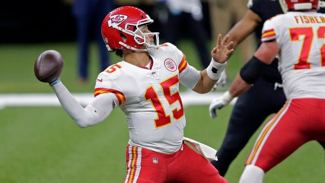 Kansas City Chiefs quarterback Patrick Mahomes (15) passes in the first half of an NFL football game against the New Orleans Saints in New Orleans, Sunday, Dec. 20, 2020.