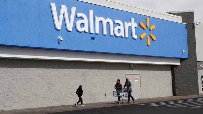 People shop at a Walmart Thursday, Feb. 6, 2020, in El Paso, Texas. The Justice Department is suing Walmart, alleging the company unlawfully dispensed controlled substances through its pharmacies, helping to fuel the opioid crisis in America, a person familiar with the matter told The Associated Press. The civil complaint being filed Tuesday, Dec. 22, 2020 points to the role Walmart's pharmacies may have played in the crisis by filling opioid prescriptions and by unlawfully distributing controlled substances to the pharmacies during the height of the opioid crisis, the person said.