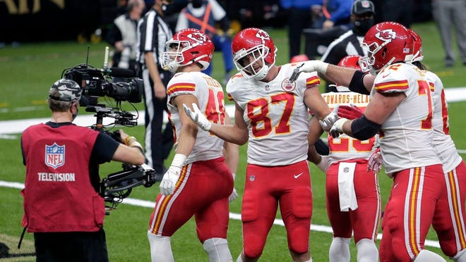 Kansas City Chiefs tight end Travis Kelce (87) celebrates his touchdown reception in the first half of an NFL football game against the New Orleans Saints in New Orleans, Sunday, Dec. 20, 2020.