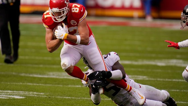 Kansas City Chiefs tight end Travis Kelce is tackled by Atlanta Falcons Foyesade Oluokun during the first half of an NFL football game, Sunday, Dec. 27, 2020, in Kansas City.