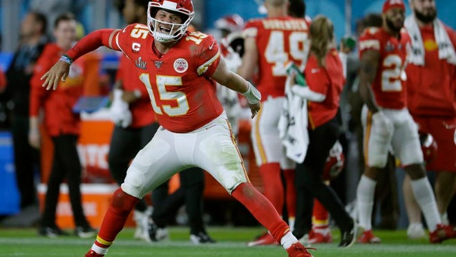 In this Feb. 2, 2020, file photo, Kansas City Chiefs' quarterback Patrick Mahomes celebrates his touchdown pass to Damien Williams in the the second half of the NFL Super Bowl 54 football game in Miami Gardens, Fla.