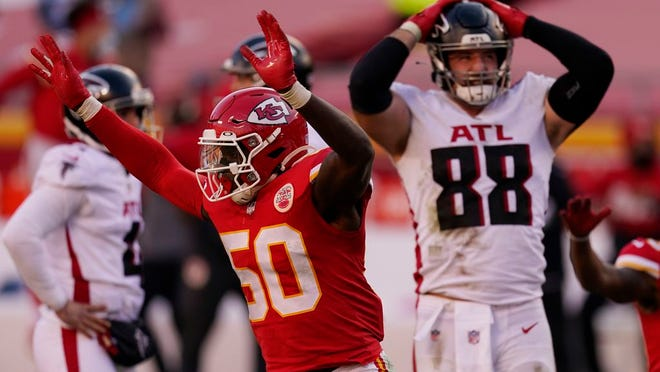 Kansas City Chiefs linebacker Willie Gay (50) reacts next to Atlanta Falcons' Luke Stocker (88) after Falcons place kicker Younghoe Koo missed a 39-yard field goal during the second half of an NFL football game, Sunday, Dec. 27, 2020, in Kansas City.