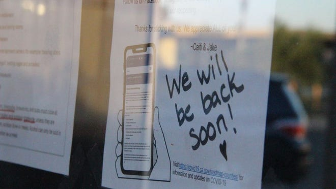 On July 21, 2020 a sign on the door to Flightline Taproom promises to reopen soon.