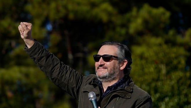 Sen. Ted Cruz, R-Texas, greets a crowd before he speaks at a campaign rally for Sen. Kelly Loeffler, R-Ga., on Saturday, Jan. 2, 2021, in Cumming, Ga.