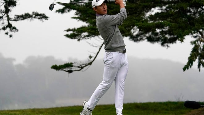In this Sunday, Aug. 9, 2020, file photo, Collin Morikawa watches his tee shot on the 16th hole during the final round of the PGA Championship golf tournament at TPC Harding Park in San Francisco. His drive to 7 feet for eagle was the defining moment of his first major title.