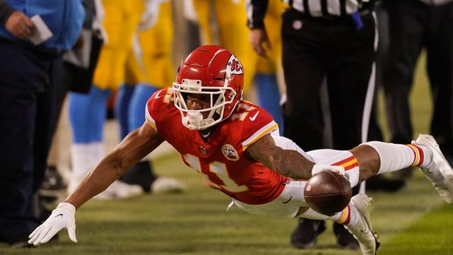Kansas City Chiefs wide receiver Demarcus Robinson dives for extra yardage during the second half of an NFL football game against the Los Angeles Chargers, Sunday, Jan. 3, 2021, in Kansas City.