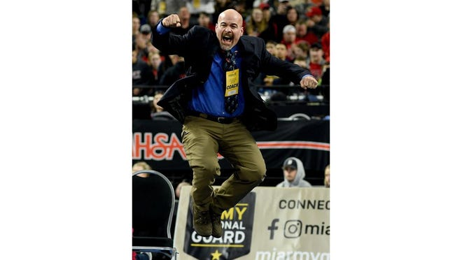 Dundee wrestling coach Tim Roberts jumps for joy after Tyler Swiderski won an individual state championship in March. Roberts has been named the national coach of the year.