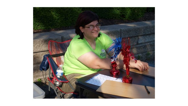 Lisa Kupla of Redford hosted the petition table Saturday in Monroe.