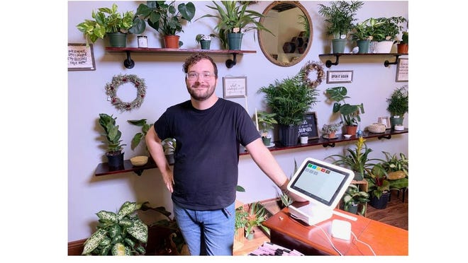 Stuart Eastman, 30, of Monroe recently opened The Conservatory, a plant shop in downtown Monroe.