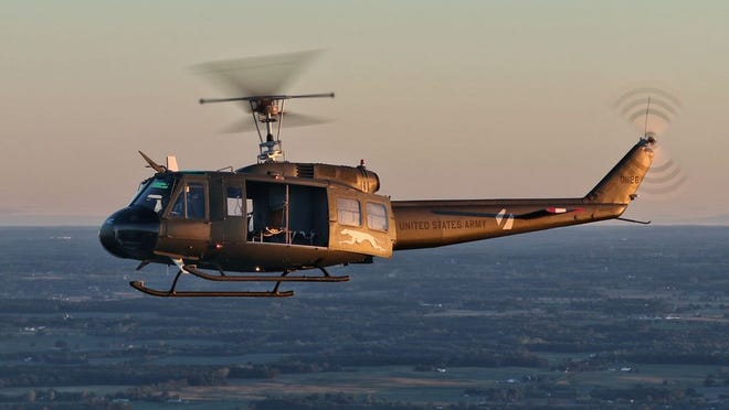 "A Huey helicopter dubbed ""Greyhound"" is part of the Yankee Air Museum's collection."