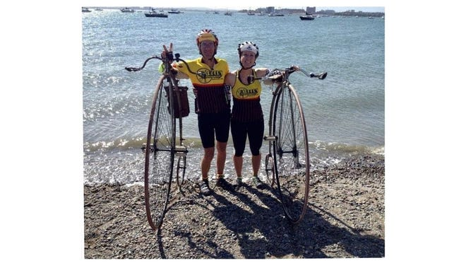 Randy Oleynik of Carleton and his daughter, Amy, are riding high-wheel bicycles from northern Michigan to Key West, Florida.