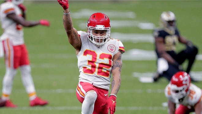 Kansas City Chiefs strong safety Tyrann Mathieu (32) reacts after a pass breakup in the second half of an NFL football game against the New Orleans Saints in New Orleans, Sunday, Dec. 20, 2020.