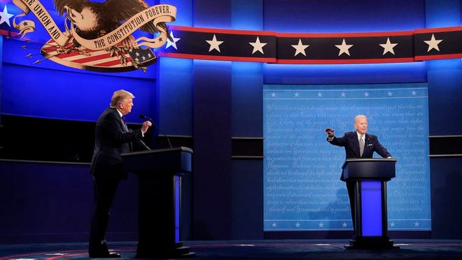 President Donald Trump, left, and Democratic presidential candidate former Vice President Joe Biden, right, gesture during the first presidential debate Tuesday at Case Western University and Cleveland Clinic in Cleveland, Ohio.