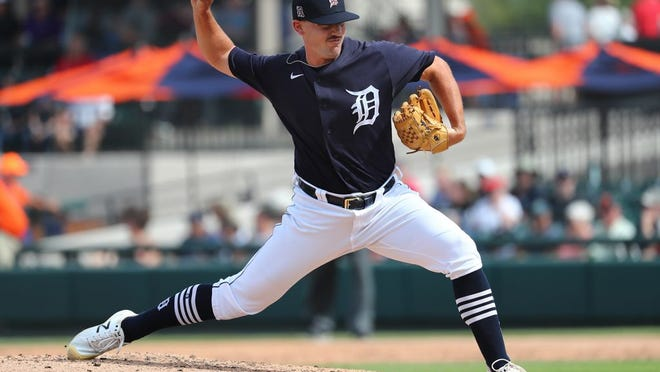 John Schreiber throws a pitch during spring training game for the Detroit Tigers on March 5.