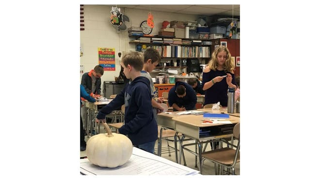 Jessica Thompson, a fifth-grade science instructor at the middle school whose class during the 2019-20 school year is pictured, said grant funds were used to buy high-powered microscopes, a 3-D printer and four Chrome books that can be used in classrooms at both the middle school and high school.