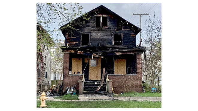 The City of Monroe continues its efforts to raze the remains of this house at 229 Harrison St., which was ravaged by fire in early May.