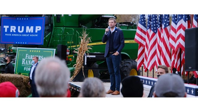 Eric Trump speaks about his father's bid for reelection as president Tuesday night during a rally in Maybee at the Elgin and Joanne Darling Family Farm.
