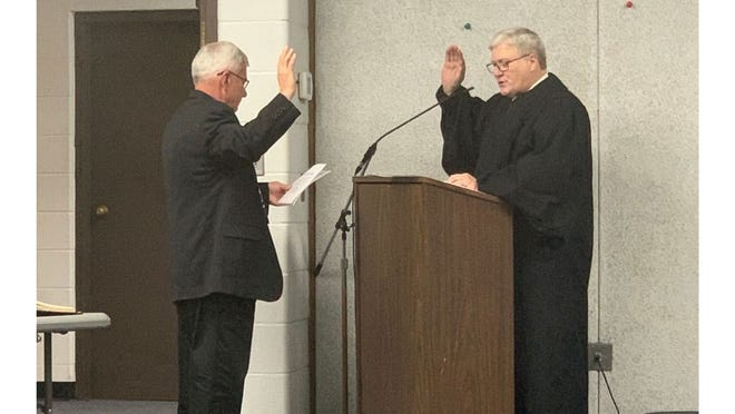 Monroe Charter Township Supervisor Alan Barron takes the Oath of Office at a special ceremony Tuesday night at township hall. 38th Circuit Court Judge Michael Weipert administers the oath, which was given to all elected officials in the township.