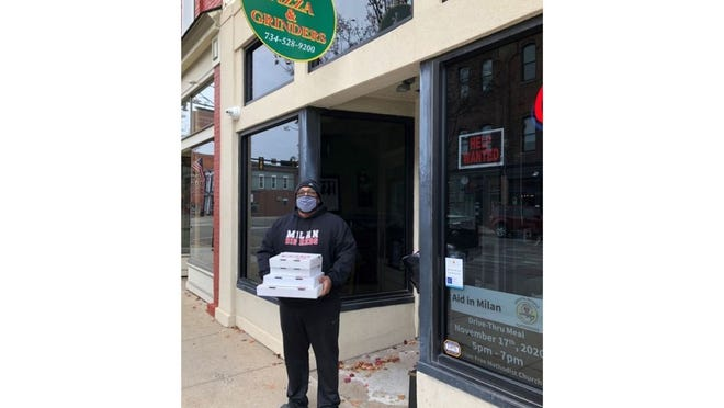 """Customer Bobby Russell of Milan takes his food from the new Sub Shop on Main street. He says he's tried this restaurant before, and it's """"Very good."""""""