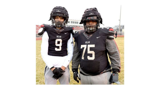 JJ Stines (9) and his cousin Travon Stines are teammates on Milan's football team, which will play Saturday in the regional finals. Their family has helped the Big Reds excel for the past three decades.
