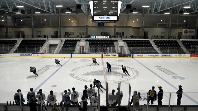 In this Jan. 5, Members of the St. Louis Blues practice during NHL hockey training camp in Maryland Heights, Mo. The Blues announced Monday, Jan. 11, 2021, that 300 fans will be allowed in for the home opener on Jan. 18 against San Jose.