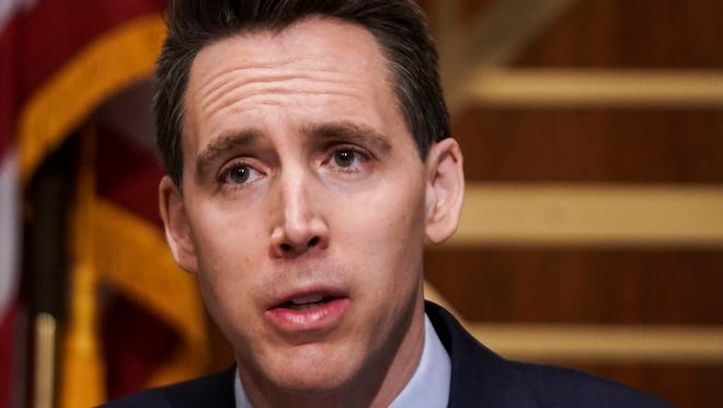 Sen. Josh Hawley, R-Mo., asks questions during a Senate Homeland Security and Governmental Affairs Committee hearing to discuss election security and the 2020 election process on Wednesday, Dec. 16, 2020, on Capitol Hill in Washington.