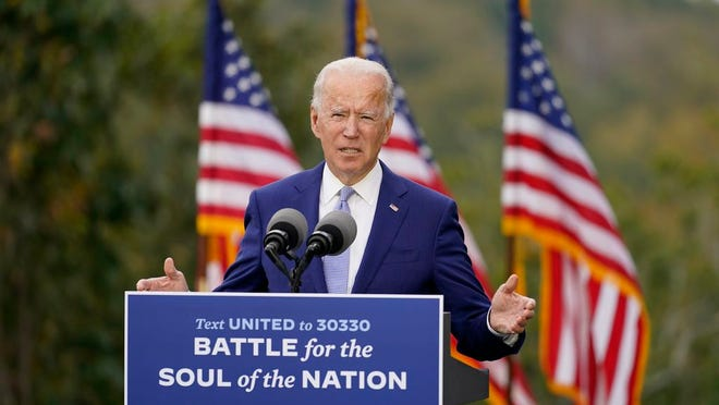FILE - In this Oct. 27, 2020, file photo, then-Democratic presidential candidate former Vice President Joe Biden speaks at Mountain Top Inn & Resort in Warm Springs, Ga. President-elect Joe Biden has evoked Franklin Delano Roosevelt in promising a remaking of America unseen since the New Deal. Pledging to emulate some of the loftiest reforms in the nation's history has left him with towering promises to keep. And Biden hopes to deliver against the backdrop of the pandemic and searing national division.