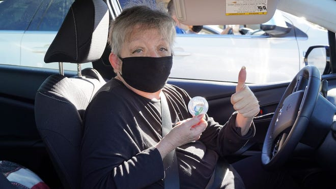 Former Mayor Peggy Breeden gives a thumbs-up after receiving a COVID-19 vaccine as part of a test run drive-thru clinic at RRH Friday. Vaccines were temporarily halted as of Tuesday due to concerns over a potentially bad batch (none of which was used in Ridgecrest), but will resume again once the hospital gets the OK from the state.