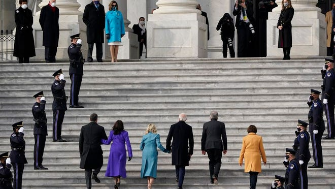 President-elect Joe Biden, his wife Jill Biden and Vice President-elect Kamala Harris and her husband Doug Emhoff arrive at the steps of the U.S. Capitol for the start of the official inauguration ceremonies, in Washington, Wednesday, Jan. 20, 2021. Speaker of the House, Nancy Pelosi waits at left.