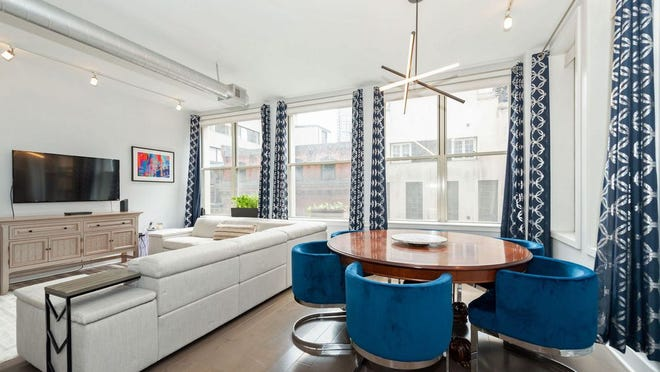 A corner exposure in the flexible open living-dining room space is one option to set up a table to enjoy a fine meal.